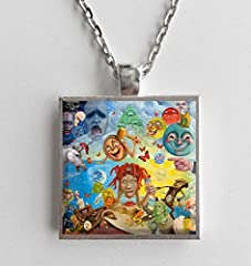 "This is a necklace featuring album art of the ""Life's a Trip"" record by Trippie Redd in a silvertone metal setting with glass. The album cover pendant is 1"" and on a 20"" long silvertone neck chain. The necklace is individually handcrafted by ..."
