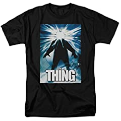The Thing (also known as John Carpenter's The Thing) is a 1982 American science fiction horror film directed by John Carpenter, written by Bill Lancaster, and starring Kurt Russell. This high quality black mens adult t-shirt depicts the origi...