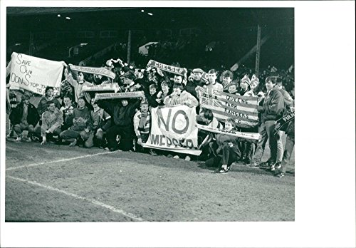 Vintage photo of Fulham F.C. supporters protest at halftime