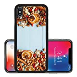 Liili Premium Apple iPhone X Aluminum Backplate Bumper Snap Case IMAGE ID 33412529 Christmas background nuts dried oranges spices and gingerbread cookies Viewed from above