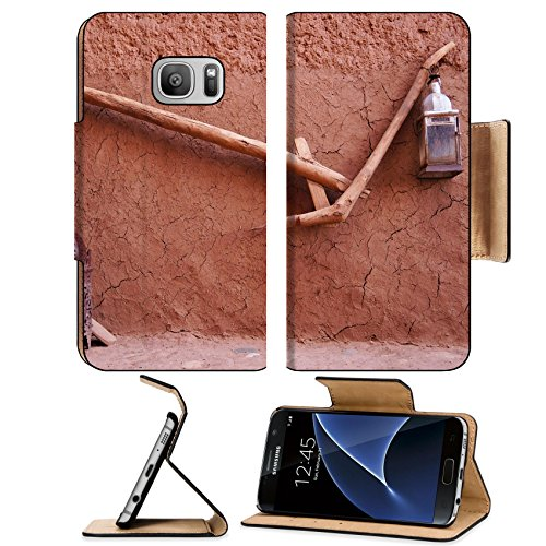 Luxlady Premium Samsung Galaxy S7 Flip Pu Leather Wallet Case IMAGE ID: 23803210 Wood plough and lamps at Kasbah Ait Ben Haddou in (Ait Carbon)