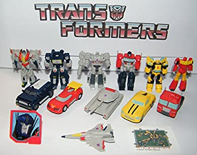 Transformers Deluxe Plastic Figure Set of 14 Toy Kit with 12 Figures, Special Tattoo and ToyRing featuring Optimus Prime with 6 Transformer Figures and 6 Vehicles!