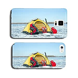 Snowshoes left in front of orange tent in winter forest cell phone cover case iPhone6