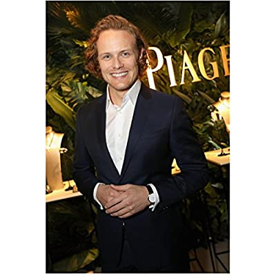 Sam Heughan 8 Inch x10 Inch Photograph Outlander A Princess for Christmas First Light Gold Letters in Background Pose 1 kn
