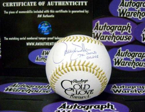Inscribed Gold Glove (Larry Walker autographed Gold Glove baseball sweetspot (Expos Rockies) inscribed 7x G G AW Certificate of Authenticity Hologram)