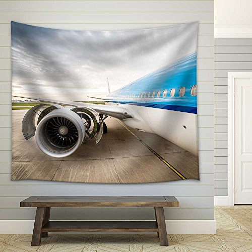 Airplane on the airport Checking condition of huge engine Fabric Wall Tapestry