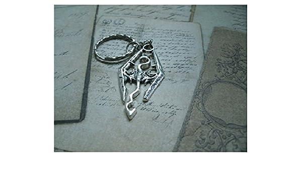Llavero o collar o pendiente que representa un dragón en el ...