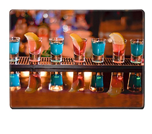 Luxlady Placemats IMAGE ID 7989476 Row of shots on the bar tequila and blue curacao