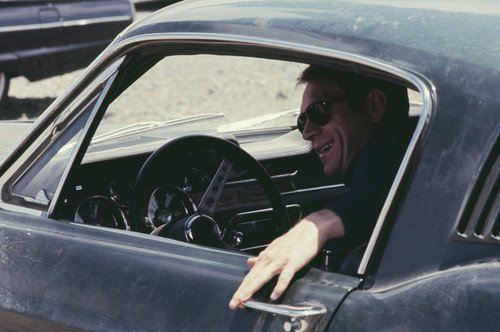 390 Glasses - Steve McQueen in Bullitt smiling in classic Ford Mustang 390 GT on film set wearing cool sunglasses rare image 24x36 Poster