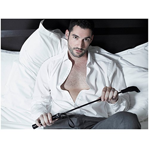 Lucifer with Tom Ellis Lucifer Morningstar on Bed Shirt Open Holding Riding Crop 8 x 10 inch photo