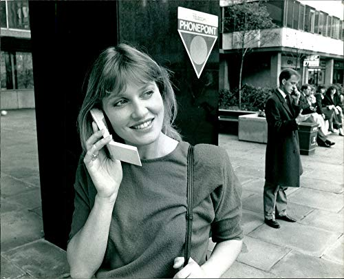 Vintage photo of A Portrait of a girl smiling while using her mobile phone.