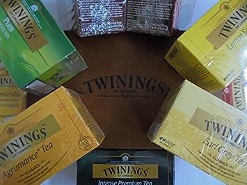 Twinings - Tea collection - Una selección de 100 tipos de té Twinings - Infusiones, té de manzanillas, etc - Incluye una taza + caja de madera de cuatro compartimientos para bolsitas de té: Amazon.es: Hogar
