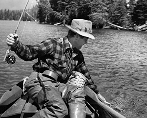 Close-up of a young man fishing for trout in a lake Yellowstone Lake Yellowstone National Park Wyoming USA Poster Print (18 x 24)
