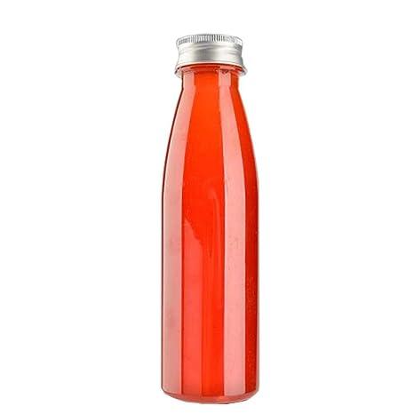 Botellas de jugo desechables transparentes de la taza de la ...