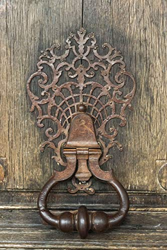 (A well worn and weathered door knocker in Place des Vosges Paris France 13x19