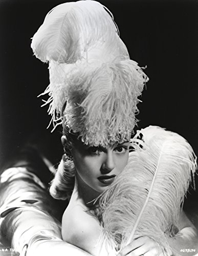 Lana Turner posed in Feathery Dress with Black Background Photo Print (24 x 30)]()