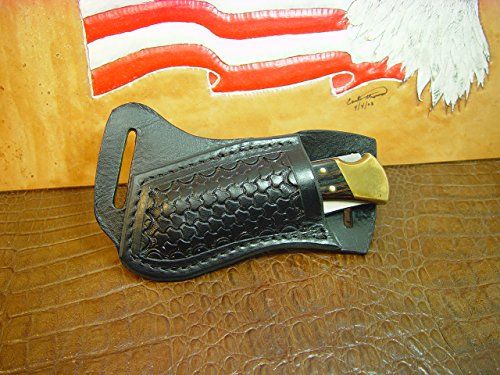 Custom left hand cross draw knife sheath for a buck 110 knife. The sheath is made out of buffalo hide leather hand tooled with a basket weave - Sheath Side Draw