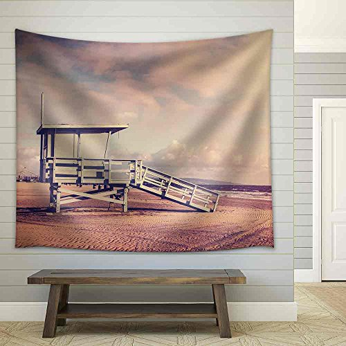 Vintage retro picture of wooden lifeguard tower Beach in California USA Fabric Wall