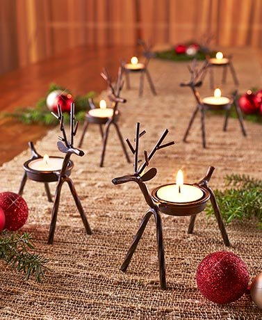 Set of 6 Reindeer Tea Light Holders]()