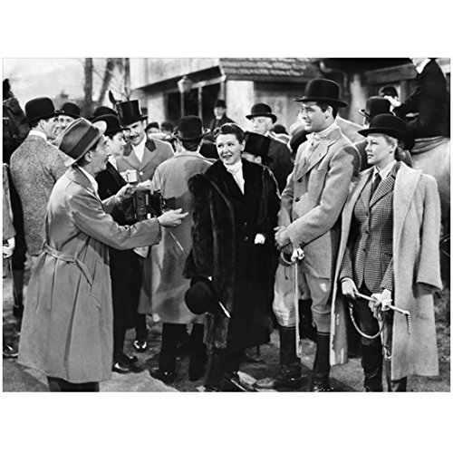 Cary Grant 8 inch x 10 inch PHOTOGRAPH Grant in Equestrian Hat Suit Boots with 2 Ladies in Equestrian Wear and Coats Talking to Man in Suit Coat Hat Crowd Behind Them Full Black and white