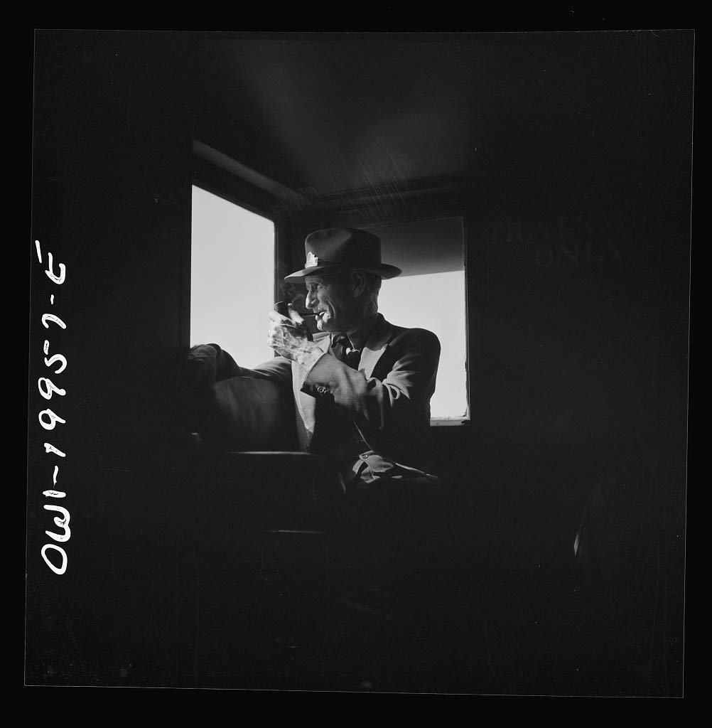 Reproduced Photo of Conductor J.R. Crawford, watching the train from his window in the cupola of the caboose along the Atchison, Topeka, and Santa Fe Railroad between Canadian a 1943 Delano C Jack 64a