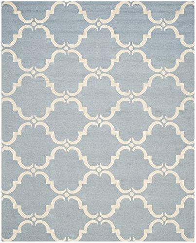Safavieh Cambridge Collection CAM703B Handmade Moroccan Geometric Blue and Ivory Premium Wool Area Rug (8′ x 10′)