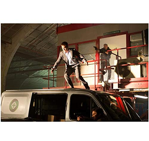 (Jack Ryan: Shadow Recuit Chris Pine as Jack escaping onto car 8 x 10 Inch Photo)