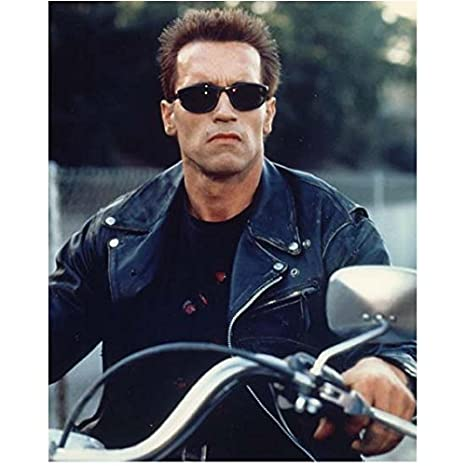 a8ccb377e2 Arnold Schwarzenegger 8 inch x10 inch Photo The Terminator Predator Total  Recall Wearing Sunglasses   Black Leather Jacket on Motorcycle kn at  Amazon s ...