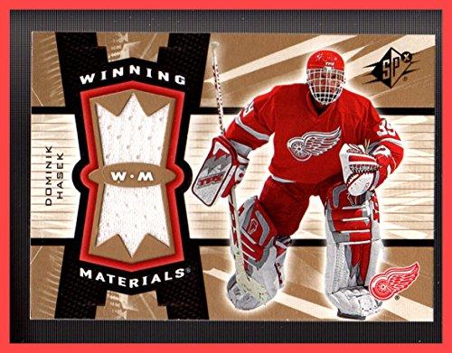 Wing Dual (2006-07 SPx Winning Materials GAME USED JERSEY #WMHK Dominik Hasek Dual White DETROIT RED WINGS)