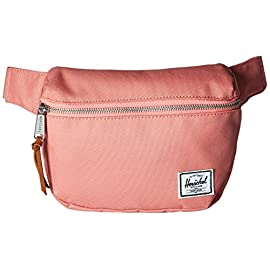 Herschel Supply Co. Fifteen Hip Pack 5 Signature striped fabric liner Exposed zipper with knotted leather pull Clip-fastened adjustable webbing strap