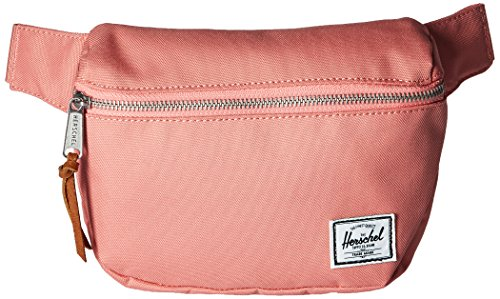 Herschel Supply Co. Fifteen Hip Pack 1 Signature striped fabric liner Exposed zipper with knotted leather pull Clip-fastened adjustable webbing strap