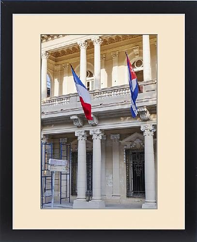 Framed Print of West Indies, Cuba, Havana. French and Cuban flags fly from building by Fine Art Storehouse