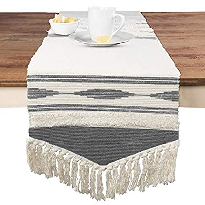 KIMODE Moroccan Fringe Table Runner 14 in x 87 in, Bohemian Geometric Cotton Handmade Woven Tufted Tassels Farmhouse Dinning Table Linen Machine Washable Minimalist Home Decorative - FITS TABLES FOR 6 to 8 PEOPLE: 14 in x 87 in ( Length 87 inch not include tassel ); macrame runner with extra in long handmade woven snazzy tassels on each side,gives a chic feeling and creates a relaxed mood in your room. CLASSY MATERIAL AND UNIQUE DESIGN: Fringe table runner use exquisite cutting with premium quality cotton and hemp fabric,add fringe and tufted vibe on this table runner,black and white colored lines looks more romantic and minimalist. MULTIFUNCTIONAL UTILIZATION: Suitable for most rectangular table, round table, and square table, and it not only moroccan decor dining table but also tea table, shoe cabinet, and TV stand, etc;great gift at housewarmings, holidays and birthdays. - table-runners, kitchen-dining-room-table-linens, kitchen-dining-room - 51gZtfybX7L. SS400  -