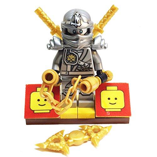 MinifigurePacks: Lego Ninjago Bundle (1) Zane Minifigure - Titanium Variant (1) Figure Display Base (4) Figure Accessory's (Shamshir Swords - Throwing Stars (Shuriken) - Nunchucks)