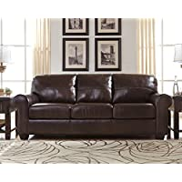 Ashley Canterelli Collection 9800238 92 Sofa with Leather Cushions Coil Seating Rolled Arms Tri-Block Feet Stitched Detailing and Contemporary Style in