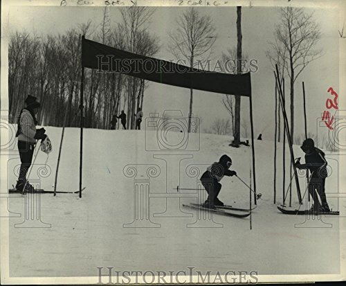 Historic Images Press Photo Skier Chris Nightengale crosses finish line after a slalom run - 8.25 x 10