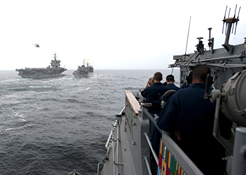 Home Comforts Sailors Aboard The Guided-Missile Cruiser USS Vicksburg (CG 69) Observe as The Aircraft Carrier USS