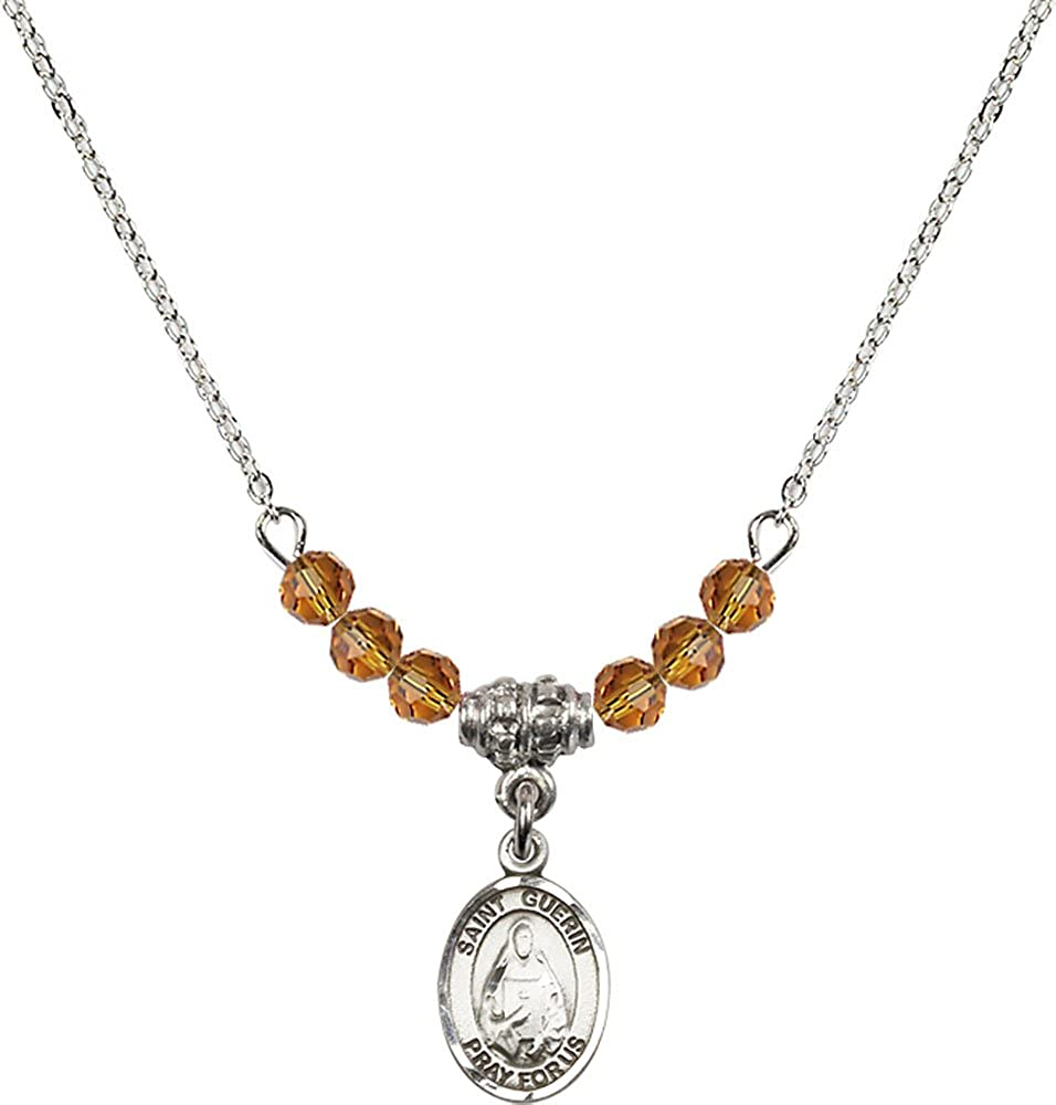 18-Inch Rhodium Plated Necklace with 4mm Topaz Birthstone Beads and Sterling Silver Saint Theodora Charm.