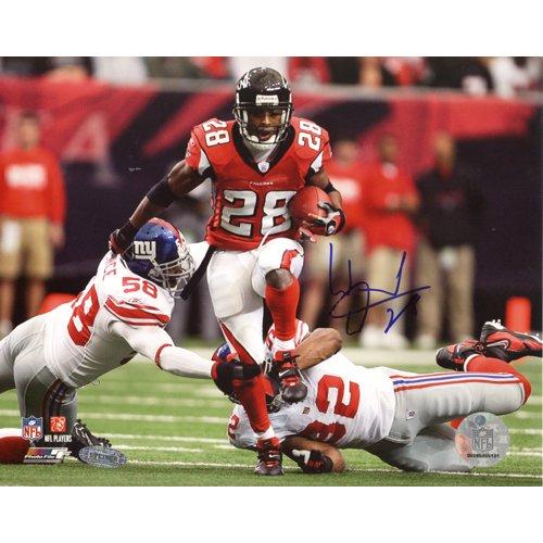 (NFL Warrick Dunn Run Vs Giants Autographed 8-by-10-Inch Photograph)