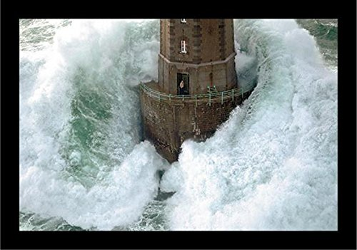 - FRAMED La Jument Phares Dans La Tempete Lighthouse Photograph by Jean Guichard 27.5x18.5 Art Print Poster Wall Decor Famous Image Lighthouse with Crashing Wave Man Standing outside