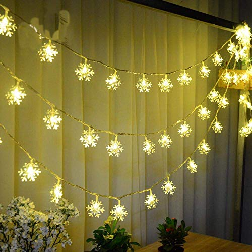 Snowflake Led String Lights 40ft/100 LEDs Plug in Indoor & Outdoor Christmas Lights with 8 Changing Model Waterproof Decorative Lights for Bedroom, Patio, Garden, Gate,Yard,Party (Warm White) -