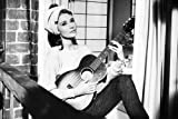 #8: Audrey Hepburn in Breakfast at Tiffany's 24x36 Poster playing guitar
