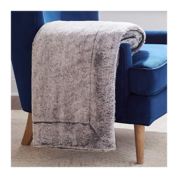 "Amazon Brand – Rivet Faux Fur Throw Blanket, Soft and Stylish, 80"" x 60"", Black - The contrasting textures of this throw make it a visually interesting piece for draping. One side is plush faux fur, while the other is a simple black. Whether used in a living space or a bedroom, it will add luxury to any style decor. 80""L x 60""W Dry clean or spot clean only; do not machine wash - blankets-throws, bedroom-sheets-comforters, bedroom - 51grNhkSIYL. SS570  -"