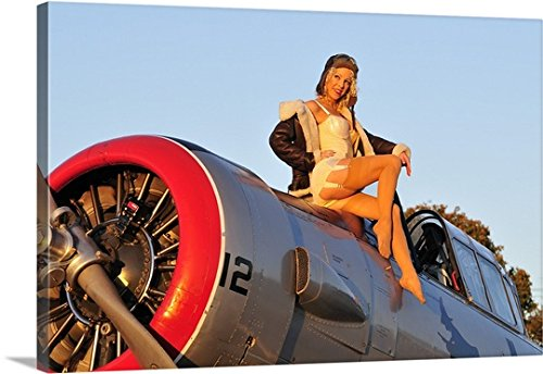 Christian Kieffer Gallery-Wrapped Canvas entitled 1940's style aviator pin-up girl posing with a vintage T-6 Texan aircraft by greatBIGcanvas