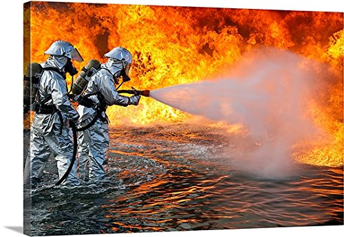 """Stocktrek Images Premium Thick-Wrap Canvas Wall Art Print entitled An aircraft rescue firefighting team attempts to spray out a fuel fire 24""""x16"""""""