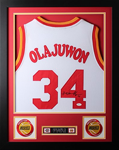 Hakeem Olajuwon Autographed White Rockets Jersey - Beautifully Matted and Framed - Hand Signed By Hakeem Olajuwon and Certified Authentic by Auto JSA COA - Includes Certificate of Authenticity