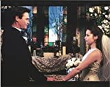 Holly Marie Combs as Piper Halliwell and Brian Krause as Leo Wyatt in Charmed facing each other in wedding scene 8x 10 photo