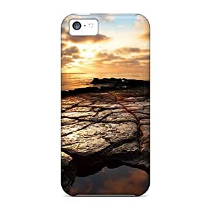 Tough Iphone CfahABo5104HagMe Case Cover/ Case For Iphone 5c(puzzled Rocks On A Beach At Sunset)