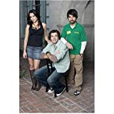 Chuck (TV Series) Zachary Levi as Chuck Bartowski Seated Outside with Others 8 x 10 inch photo