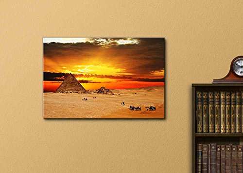 Camel Caravan Going Through Desert in Front of Pyramid at Sunset Wall Decor